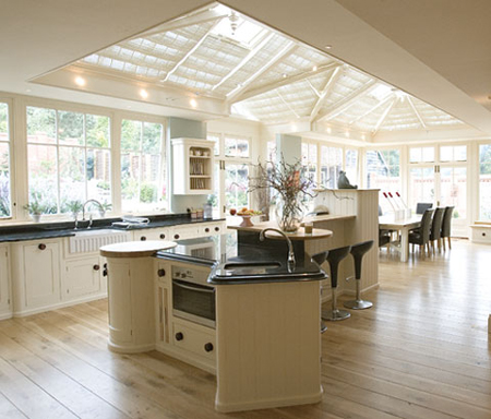 fitted kitchen and dining room in a conservatory